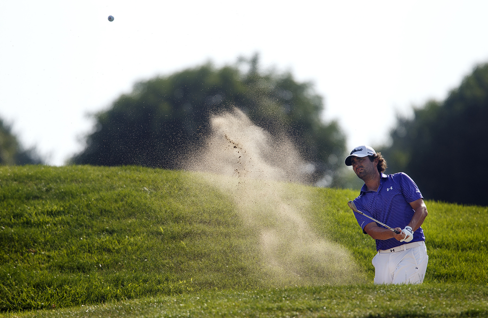 Martin Flores hits out of a bunker during the final round of the Web.com Tour Lincoln Land Charity Championship at Panther Creek Sunday, July 17, 2016. Ted Schurter/The State Journal-Register