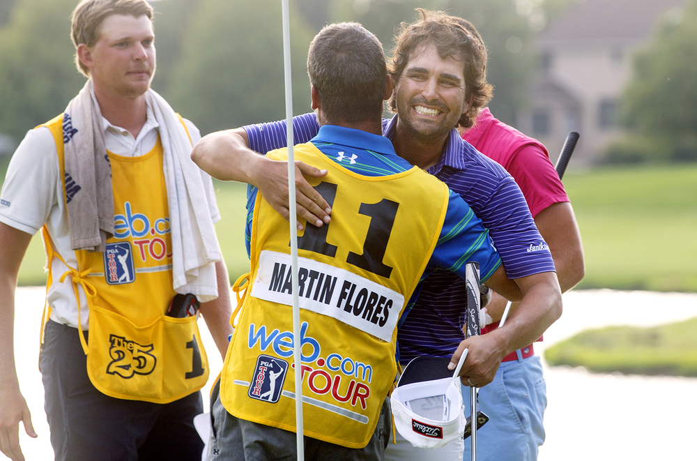 Martin Flores hugs his caddy Don Gadberry after getting the first victory of his career during the the inaugural Web.com Tour Lincoln Land Charity Championship at Panther Creek Country Club Sunday, July 17, 2016. Ted Schurter/The State Journal-Register