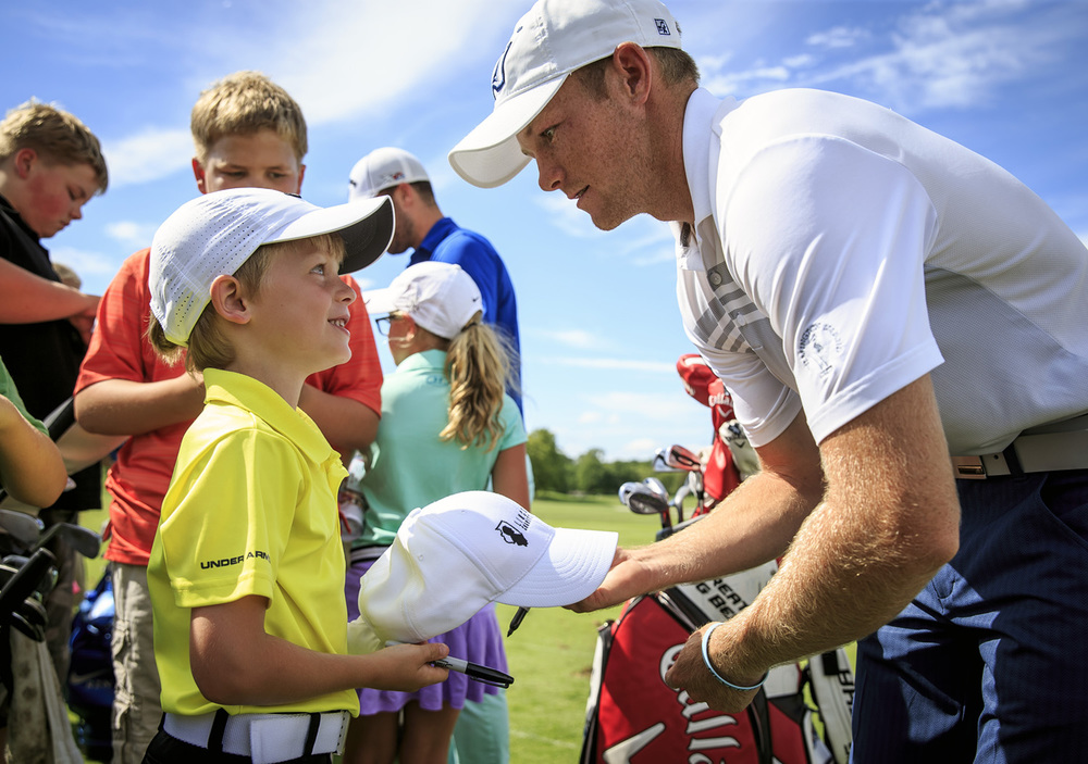 Former Sacred Heart-Griffin golfer Jake Marriott, right, asks Aidan Grant, 7, left, if he was old enough to play in the Drysdale Tournament as he gives him an autograph after a junior golf clinic for the Web.com Tour's Lincoln Land Charity Championship at Panther Creek Country Club, Tuesday, July 12, 2016, in Springfield, Ill. Marriott was a two time winner in the Drysdale, once at Pasfield in 2008 and 2010 at Lincoln Greens. He is currently on the Augusta University golf team and received a sponsor's exemption to play in the Web.com Tour's inaugural event at Panther Creek Country Club. Justin L. Fowler/The State Journal-Register