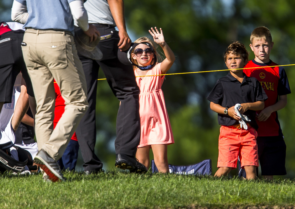 Carly Culli, 7, waves to the golfers as they come off the 18th green during the second round of the Web.com Tour's Lincoln Land Charity Championship at Panther Creek Country Club, Friday, July 15, 2016, in Springfield, Ill. Justin L. Fowler/The State Journal-Register