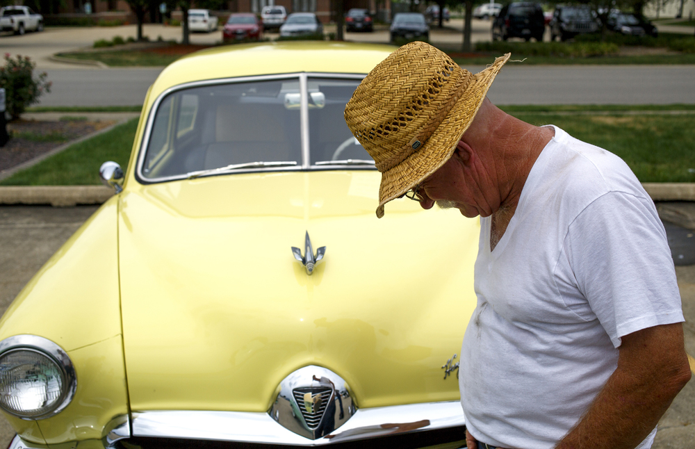Steve Farris of McLeansboro, Ill., examines one of the Kaiser Frazer automobiles at the Kaiser Frazer Owners Club National Convention at Northfield Center Wednesday, July 13, 2016. The automobiles were produced in the United States between 1946 and 1954 under a partnership between automobile executive Joseph W. Frazer and industrialist Henry J. Kaiser. The show continues today, judging begins at 9 a.m. Rich Saal/The State Journal-Register