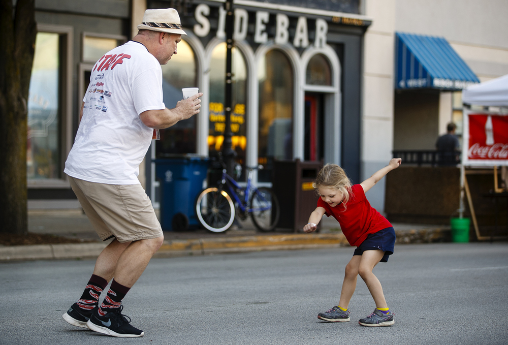 Pat Davis dances with his granddaughter Jaiden Mitchell during the Downtown Bacon Throwdown Friday, July 22, 2016. Ted Schurter/The State Journal-Register