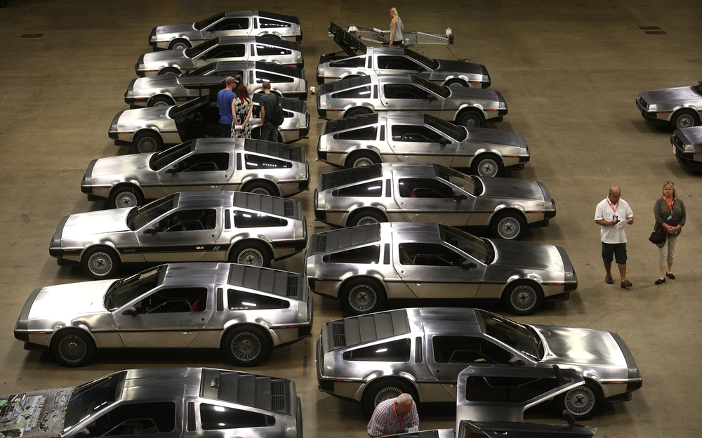 Some of the nearly 40 DeLoreans that had arrived for the show can be seen 
