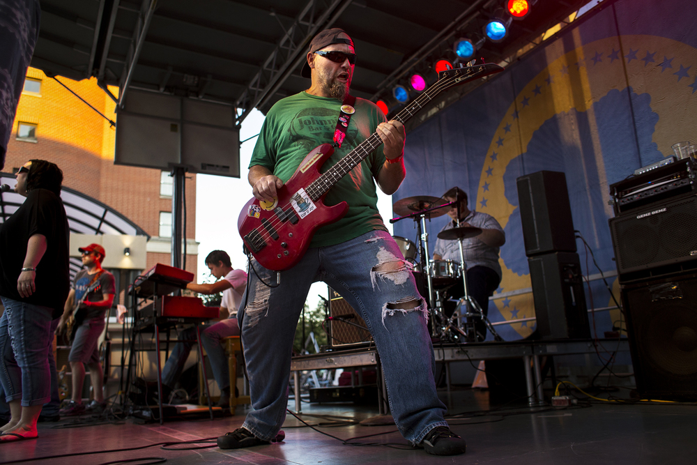 Jon Harvel plays bass with the Fireside Relics at the Downhome Music Festival in downtown Springfield Friday, July 29, 2016. Ted Schurter/The State Journal-Register