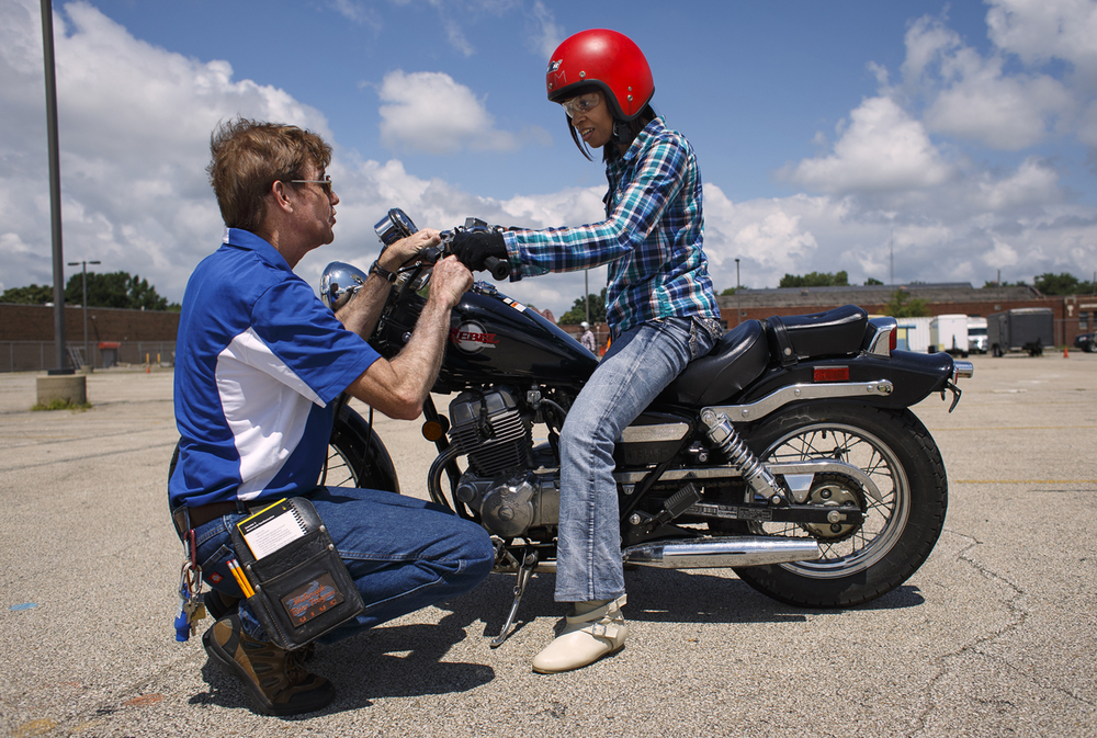 Instructor David Taylor gives Sherri Bailey some tips during the hands-on portion of the Basic Rider Course in the Motorcycle Rider Program Saturday, July 30, 2016.  The class teaches the fundamental skills of straight-line riding, shifting, turning, and stopping, then works toward developing more complex street skills including essential braking, turning and swerving techniques. Ted Schurter/The State Journal-Register