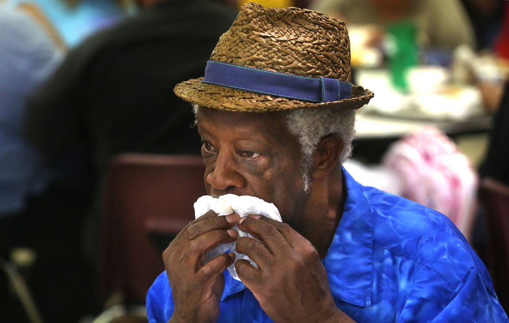 Breadline patron George Clark uses a napkin after finishing up his lunch featuring chilli on Thursday, July 28, 2016. St. John's Breadline, a project of Catholic Charities that provides free meals to anyone who shows up, will have new hours after more than 20 years. The new hours beginning Monday will be 8:00 to 10 a.m and will reopen from 2 to 4 p.m. Saturday and Sunday hours will remain the same from 10:30 a.m. to 1:30 p.m. Holiday hours will not change. David Spencer/The State Journal-Register