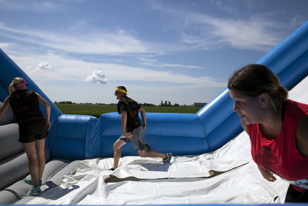Participants on one of the obstacles in the Insane Inflatable 5k fun run at Centennial Park Saturday, Aug. 6, 2016. Rich Saal/The State Journal-Register