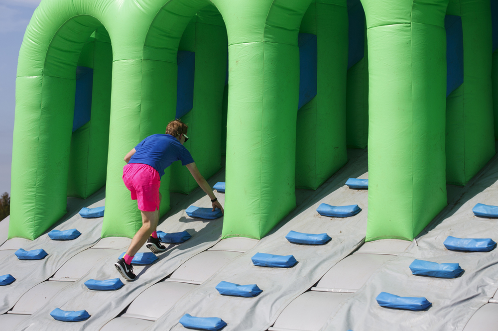 A participant enters one of the obstacles in the Insane Inflatable 5k fun run at Centennial Park Saturday, Aug. 6, 2016. Rich Saal/The State Journal-Register