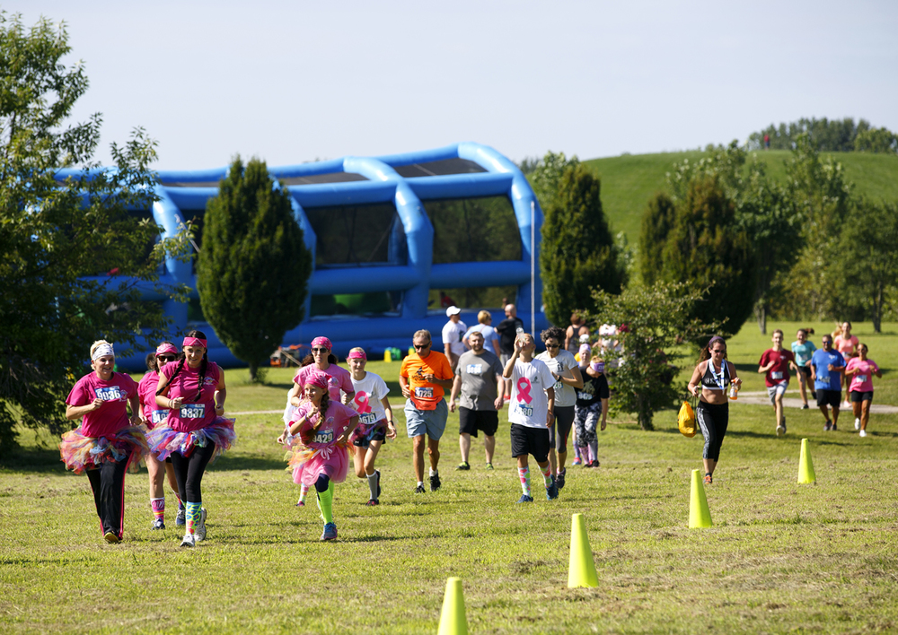 Participants in the Insane Inflatable 5k fun run at Centennial Park race toward the last obstacle and the finish line Saturday, Aug. 6, 2016. Rich Saal/The State Journal-Register