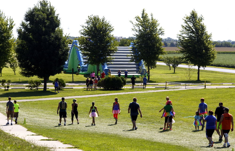 Participants walk toward one of the obstacles in the Insane Inflatable 5k fun run at Centennial Park Saturday, Aug. 6, 2016. Rich Saal/The State Journal-Register