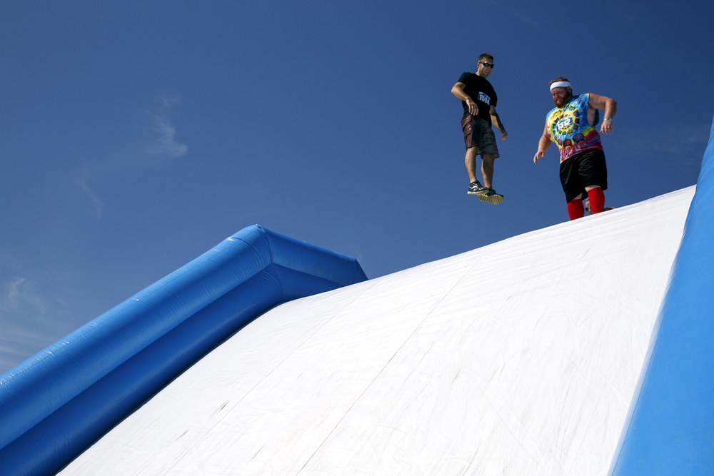 Two participants prepare to bounce their way down one of the slides at the Insane Inflatable 5k fun run at Centennial Park Saturday, Aug. 6, 2016. Rich Saal/The State Journal-Register