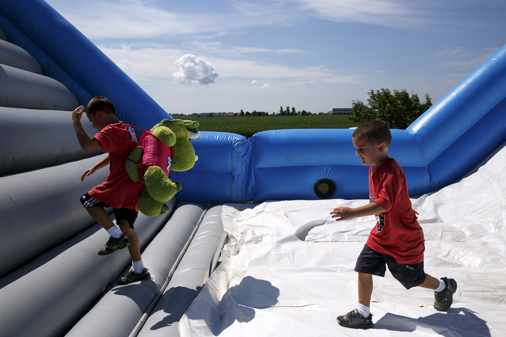Drake Saunders and his brother, Grant, make their way through one of the obstacles in the Insane Inflatable 5k fun run at Centennial Park Saturday, Aug. 6, 2016. Rich Saal/The State Journal-Register