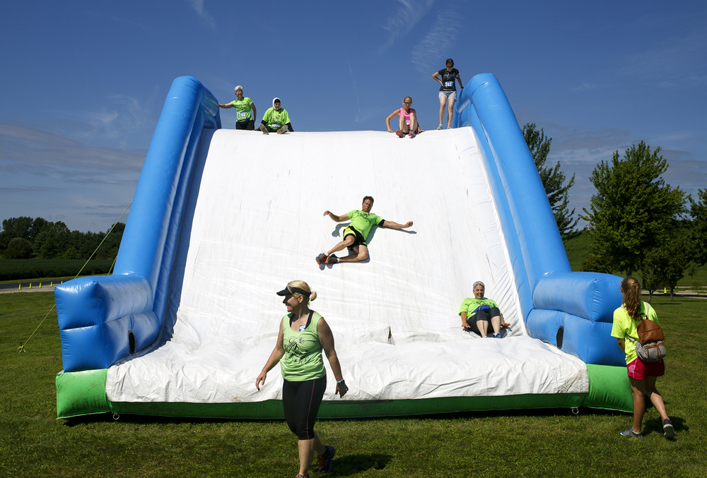 Several of the obstacles in the Insane Inflatable 5k fun run finished with a slide at Centennial Park Saturday, Aug. 6, 2016. Rich Saal/The State Journal-Register