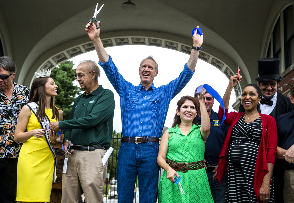 Illinois Gov. Bruce Rauner, joined by Illinois State Fair Queen 2016 Abby Foster, left, Illinois Director of Agriculture Raymond Poe, Lt. Governor Evelyn Sanguinetti and Illinois Department of Veterans Affairs Director Erica Jeffries, right, officially open the 2016 Illinois State Fair at the Main Gate to the fairgrounds, Friday, Aug. 12, 2016, in Springfield, Ill. Justin L. Fowler/The State Journal-Register