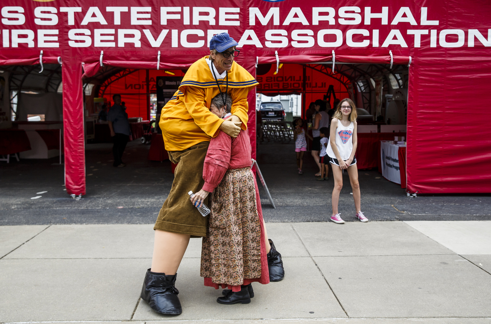 Steven Rohmer lowers his giant frame as his character, Rollo, to give Joan Jensen a hug as he makes his rounds cheering on fairgoers during the 2016 Illinois State Fair at the  Illinois State Fairgrounds, Friday, Aug. 12, 2016, in Springfield, Ill. Justin L. Fowler/The State Journal-Register