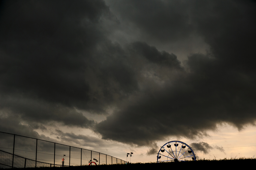 Dark clouds loom over the Illinois State Fairgrounds before torrential rains flooded the streets Friday, Aug. 12, 2016. Ted Schurter/The State Journal-Register