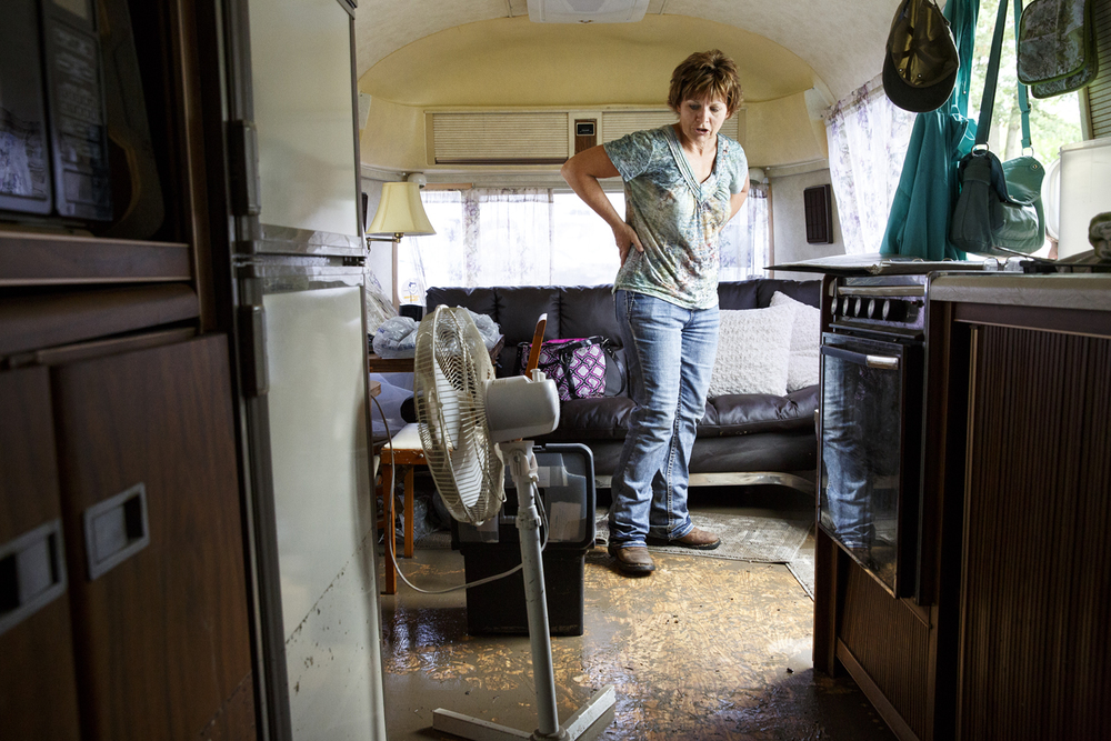 Kim Keyser and her husband Greg's Airstream camper had up to two feet of water inside when more than five inches of rain fell Friday evening and flooded Happy Hollow where they had been camping at the Illinois State Fairgrounds.The Keysers were cleaning up Saturday, Aug. 13, 2016 and believed the trailer was a total loss. Rich Saal/The State Journal-Register