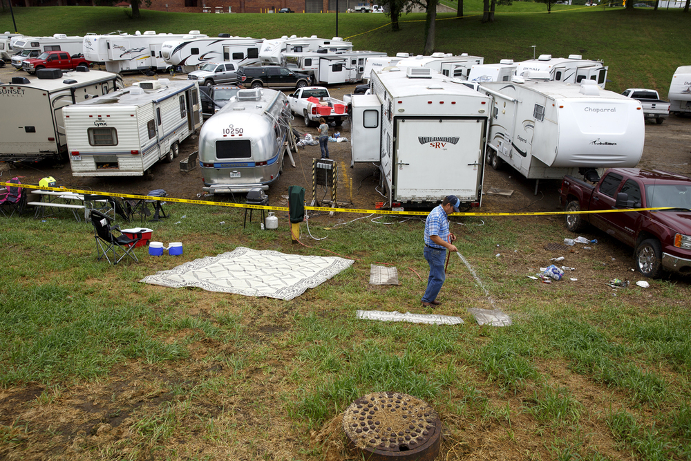 Greg Keyser hoses down rugs that had been in his camper at the Illinois State Fairgrounds Saturday Aug. 13, 2016. Heavy rain Friday evening flooded the Happy Hollow area and filled his trailer with nearly two feet of water.Rich Saal/The State Journal-Register