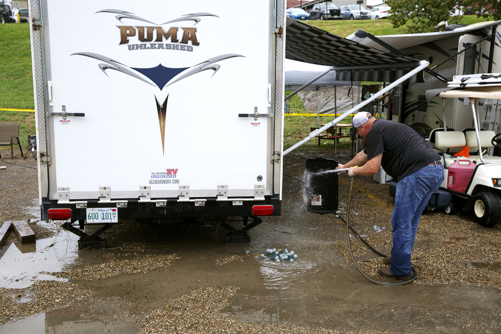 Clay Sellmeyer of Maroa cleans up around his trailer in Happy Hollow at the Illinois State Fairgrounds Saturday Aug. 13, 2016. Heavy rain Friday evening flooded the area. Rich Saal/The State Journal-Register