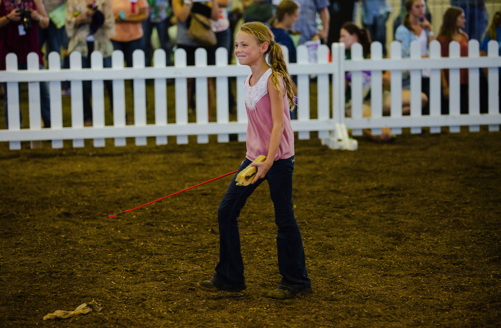 Averey Rash smiles as she walks toward her dad Andy after winning Reserve Grand Champion Wether during the Parade of Champions in the Coliseum at the Illinois State Fair Saturday, Aug. 13, 2016. Ted Schurter/The State Journal-Register