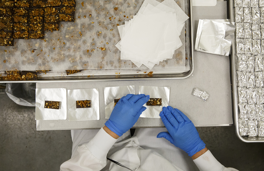 Alison Nelson packages chocolates infused with cannabis at Cresco Labs' medical marijuana cultivation center in Joliet Wednesday, Aug.10, 2016. Rich Saal/The State Journal-Register