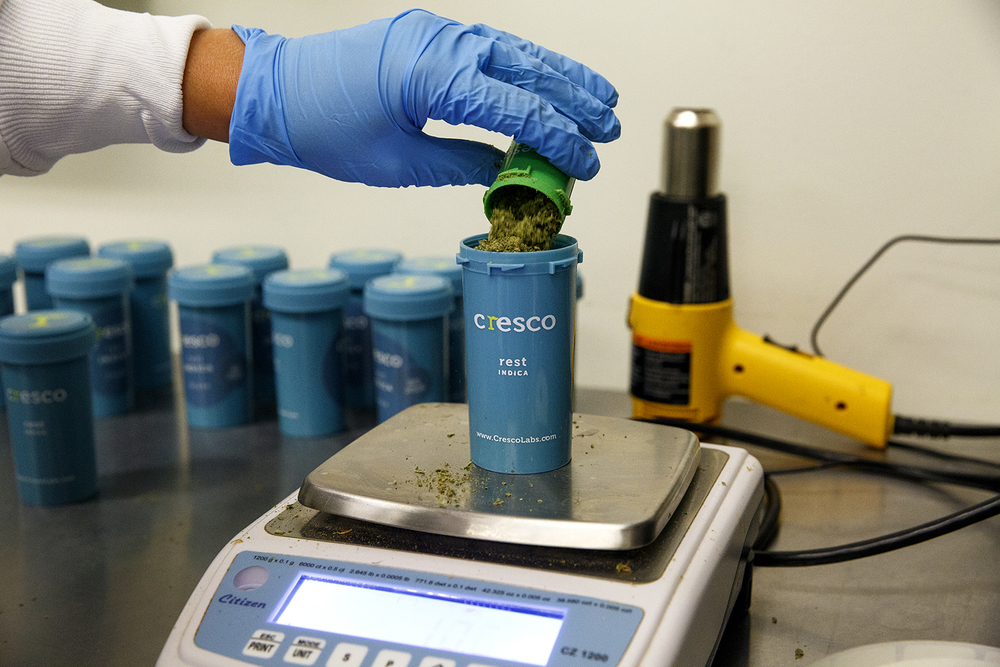 Smokable flakes of medical marijuana are weighed during the packaging process at Cresco Labs' medical marijuana cultivation center in Joliet Wednesday, Aug.10, 2016. Rich Saal/The State Journal-Register