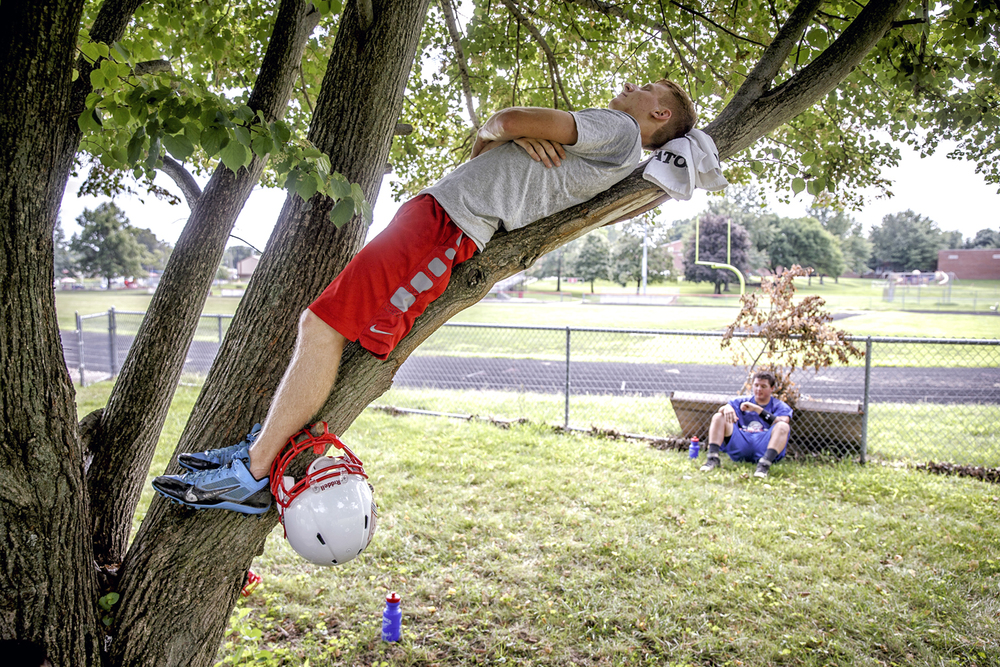 Pawnee senior Trenton Eckert finds a bit of quiet up in a tree and in the shade as the team takes a break during the first day of football practice at Pawnee High School, Monday, Aug. 8, 2016, in Pawnee, Ill. Justin L. Fowler/The State Journal-Register
