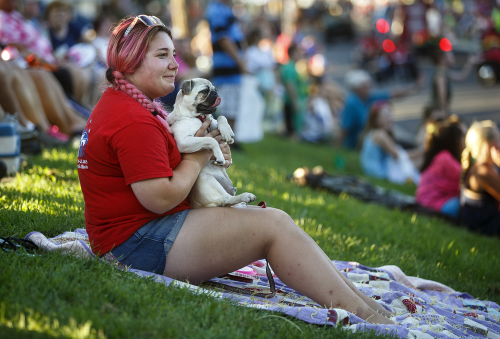 Bailey Martin and her six-month-old pug Yadi watch the Illinois State Fair Twilight Parade Thursday, Aug. 11, 2016. Ted Schurter/The State Journal-Register