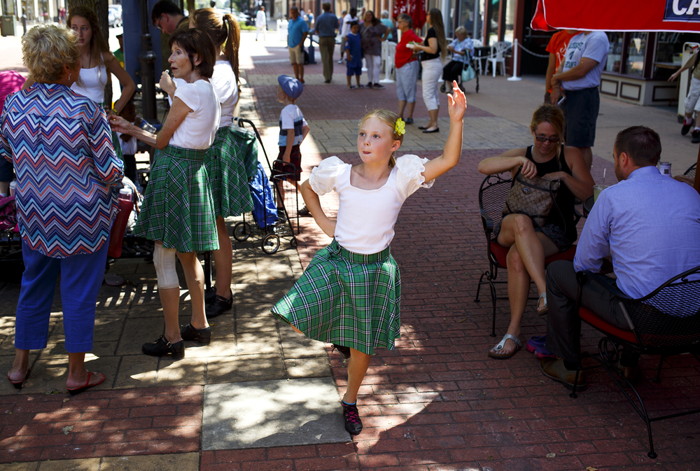 Reagan Littrell, 7, goes over her routine before dancing with the St. Andrew Society of Central Illinois at the Old Capitol Plaza Tuesday, Aug. 9, 2016. The Society, which celebrates Celtic heritage, was the featured performance group for the Artists on the Plaza series. Rich Saal/The State Journal-Register