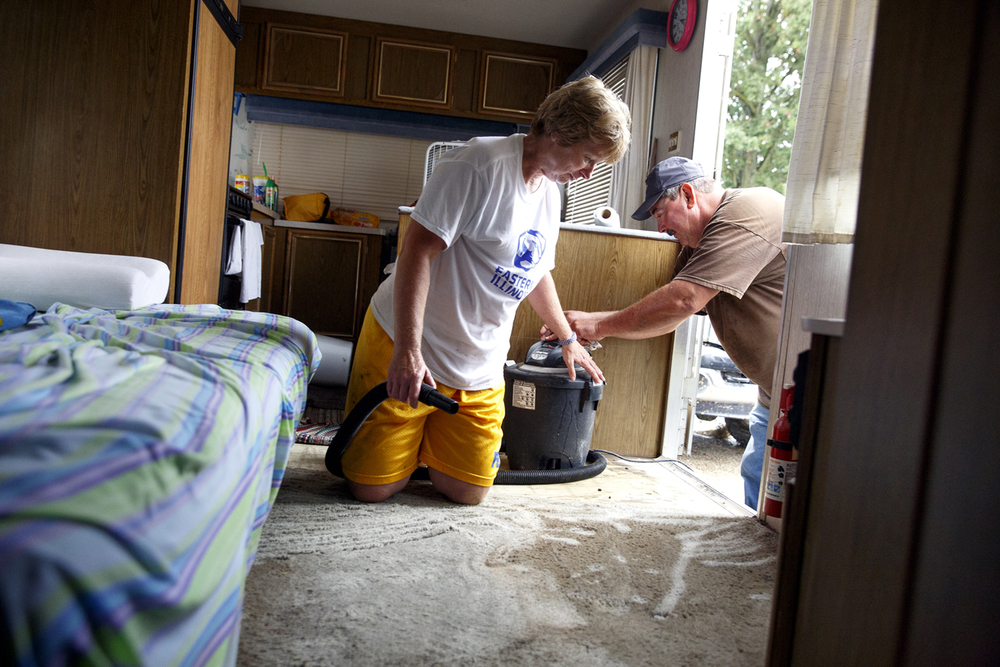 Denise and Jerry Sanders vacuum up mud and water Saturday, Aug. 13, 2016 that got into their trailer when more than five inches of rain fell Friday evening and flooded Happy Hollow where they had been camping at the Illinois State Fairgrounds. At the height of the storm, the area filled with up to five feet of water causing extensive damage to dozens of trailers and vehicles. Rich Saal/The State Journal-Register
