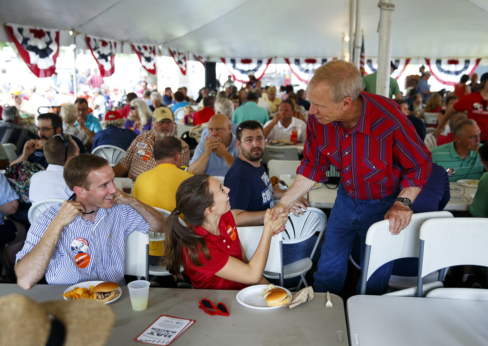 Gov. Bruce Rauner greets Ashley and Tyler Cravens at the Republican Day luncheon and rally on the Director's Lawn at the Illinois State Fair Wednesday, Aug. 17, 2016. Rich Saal/The State Journal-Register