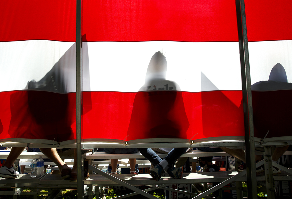 Mark Kirk supporters sit on bleachers in front of an American flag at the Republican Day rally on the Director's Lawn at the Illinois State Fair Wednesday, Aug. 17, 2016. Rich Saal/The State Journal-Register