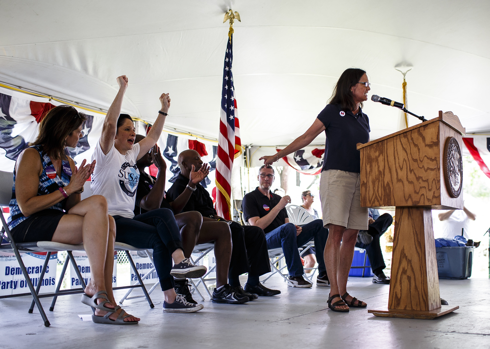 Attorney General Lisa Madigan praises the work of Secretary of State Jessie White while delivering her remarks during Democrat Day on the Directors Lawn at the Illinois State Fairgrounds, Thursday, Aug. 18, 2016, in Springfield, Ill. Justin L. Fowler/The State Journal-Register