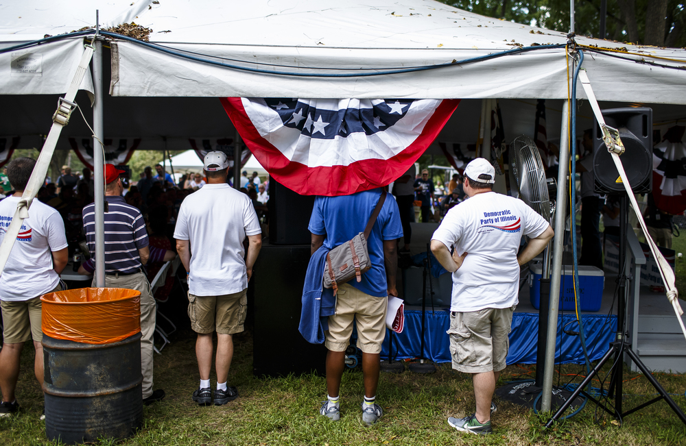 Shade was at a premium as the speeches were moved underneath a tent during Democrat Day on the Directors Lawn at the Illinois State Fairgrounds, Thursday, Aug. 18, 2016, in Springfield , Ill. Justin L. Fowler/The State Journal-Register
