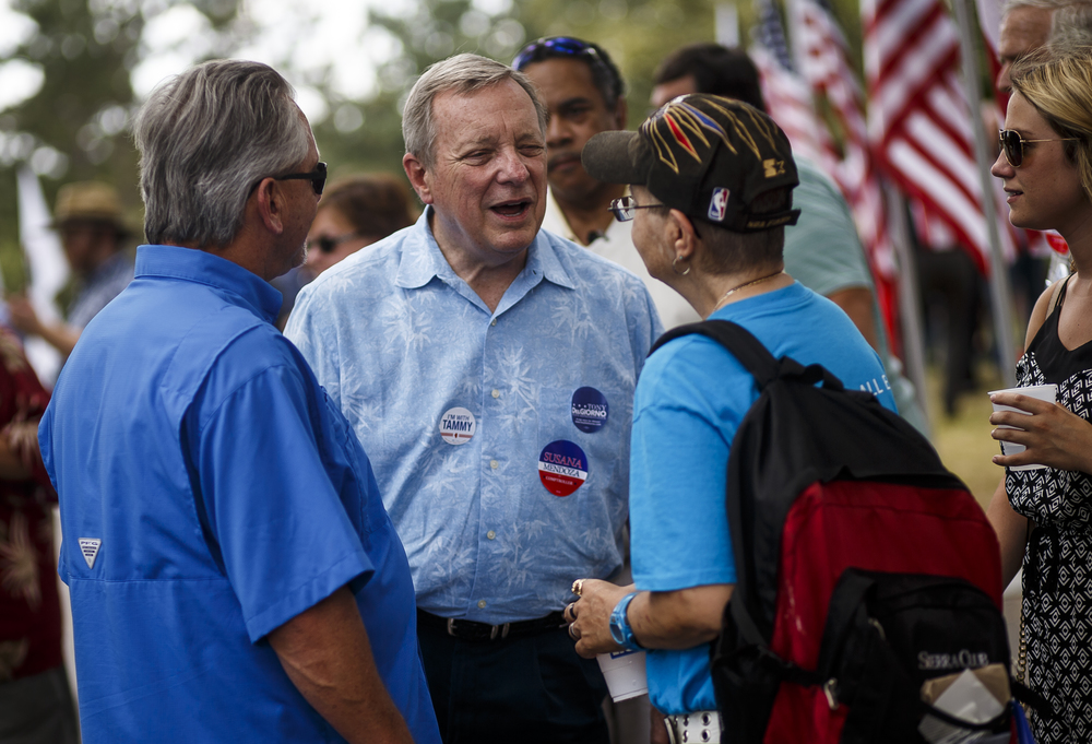 U.S. Sen. Dick Durbin talks with constituents after delivering his remarks during Democrat Day on the Directors Lawn at the Illinois State Fairgrounds, Thursday, Aug. 18, 2016, in Springfield, Ill. Justin L. Fowler/The State Journal-Register