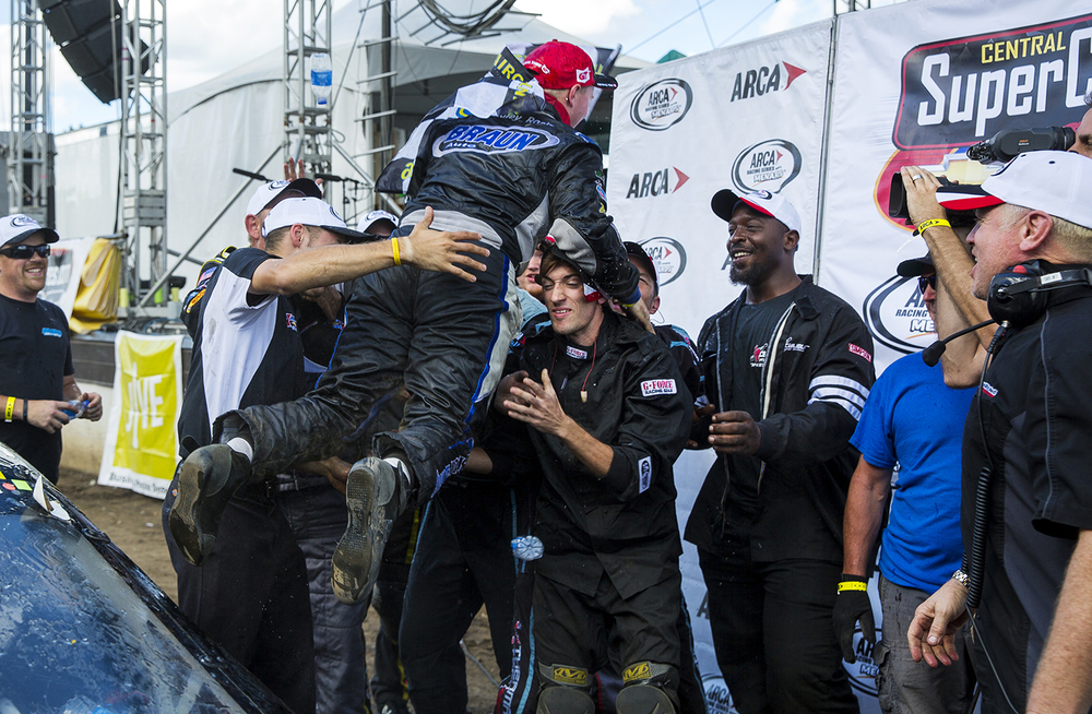 Justin Haley leaps from the top of No. 98 MMM-Braun Auto Group Chevroletthe and into the arms of his crew after winning the 54th annual SuperChevyStores.com-Allen Crowe 100 at the Illinois State Fair Sunday, Aug. 21, 2016. Ted Schurter/The State Journal-Register