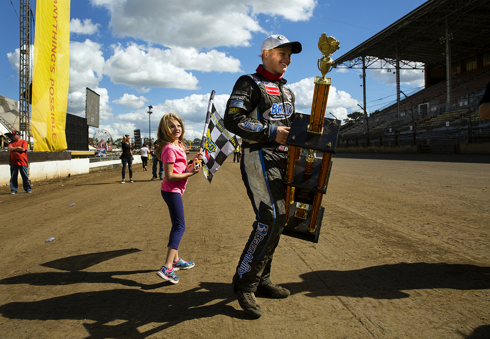 Seventeen-year-old Justin Haley carries his trophy after winning the 54th annual SuperChevyStores.com-Allen Crowe 100 and becoming the all-time youngest winner at the Illinois State Fairgrounds in championship auto racing history Sunday, Aug. 21, 2016. Ted Schurter/The State Journal-Register