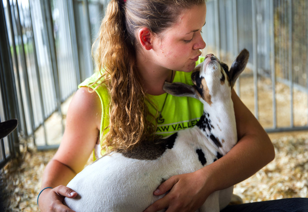 Blair Monroe of Bethany, Ill., gives Remington, her Nigerian Dwarf goat, a kiss as they take a break in the Goat Building at the Illinois State Fair Sunday, Aug. 14, 2016. Ted Schurter/The State Journal-Register