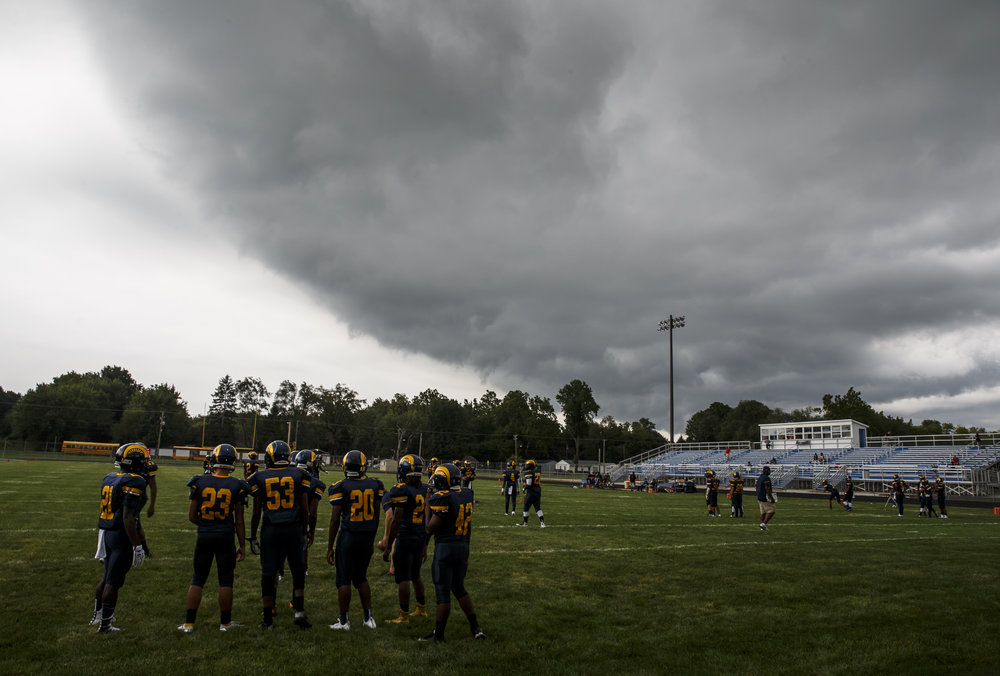 Heavy cloud cover moves over the field as the Spartans get set to take on Glenwood at Southeast High School, Friday, Aug. 26, 2016, in Springfield, Ill. Justin L. Fowler/The State Journal-Register