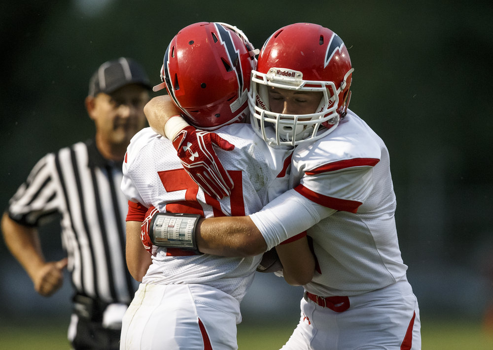 Glenwood's Austin Schiff (20) celebrates with Robbie Hansen (9) after he made an interception against against Southeast during the first half at Southeast High School, Friday, Aug. 26, 2016, in Springfield, Ill. Justin L. Fowler/The State Journal-Register