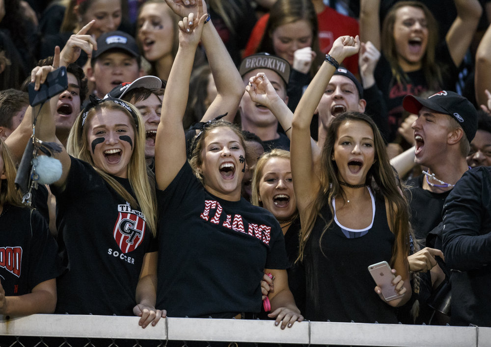 Glenwood fans celebrate the Titans 28-0 lead against Southeast during the first half at Southeast High School, Friday, Aug. 26, 2016, in Springfield, Ill. Justin L. Fowler/The State Journal-Register