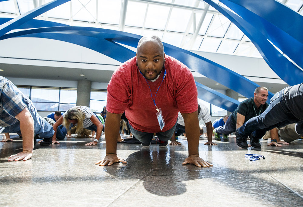 Isaiah Walton, completes the 22 Pushup Challenge, a challenge to raise awareness about the suicide rate of U.S. veterans, at the Willard Ice Building, Monday, Aug. 22, 2016, in Springfield, Ill. Employees with the Illinois Dept. of Revenue completed the challenge which hopes to raise awareness that on average 22 veterans in the United States commit suicide every day. Justin L. Fowler/The State Journal-Register