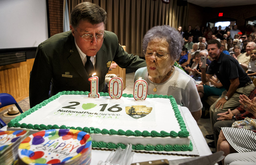 Lincoln Home Superintendent Dale Phillips, left, shares the spotlight with Springfield resident Grace Baliva, right, who was born on Aug. 25, 1916, as they celebrate not only the National Park Service Centennial, but Baliva's 100th birthday as well at the Lincoln Home National Historic Site, Thursday, Aug. 25, 2016, in Springfield, Ill. Justin L. Fowler/The State Journal-Register