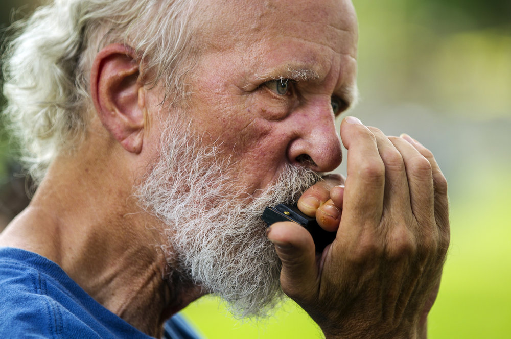 Len Clark, a member of The Woodshop Boys, plays harmonica during the Clayville Folk Music Festival Saturday, Aug. 27, 2016. Ted Schurter/The State Journal-Register