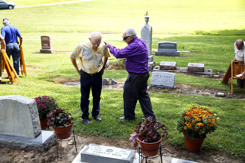 Ralph Scheldt, left, and Ray Coatney visit at the grave of Ivah J. Coles, a Macoupin County man who died in 1904 trying to save a friend from drowning in a Gillespie reservoir. Coatney is a descendant of the Coles family by marriage. Ivah Coles was just 21 when he died and his mother received the Andrew Carnegie Hero Medal to commemorate her son's heroic act. Because of efforts by the Macoupin County Historical Society, the Pennsylvania Association of Numismatists, Carlinville Monument and the Carnegie Fund Commission, a headstone and Carnegie Hero grave marker were dedicated Wednesday, Aug. 24, 2016 during a ceremony at Coles' formerly unmarked grave in Bunker Hill cemetery. Rich Saal/The State Journal-Register