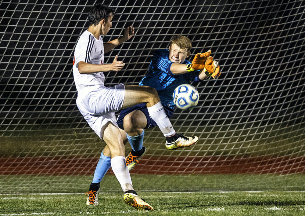 Rochester goalkeeper Cody Frey (00) leaps out to make a save against Glenwood's Jackson Nourie (10) in the second half at Glenwood High School, Tuesday, Aug. 30, 2016, in Chatham, Ill. Glenwood defeated Rochester 2-0.  Justin L. Fowler/The State Journal-Register