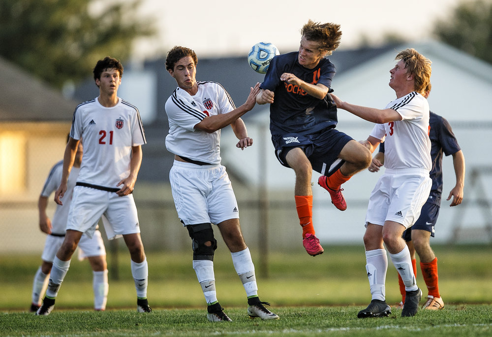 Rochester's Jacob Milnes (10) tries to smack a header on goal against Glenwood's Reilly Fay (18) in the first half at Glenwood High School, Tuesday, Aug. 30, 2016, in Chatham, Ill. Justin L. Fowler/The State Journal-Register