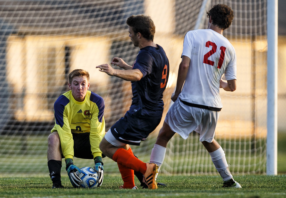 Glenwood goalkeeper Jake Volker (0) makes save in front of Rochester's Jake Duban (9) in the first half at Glenwood High School, Tuesday, Aug. 30, 2016, in Chatham, Ill. Justin L. Fowler/The State Journal-Register