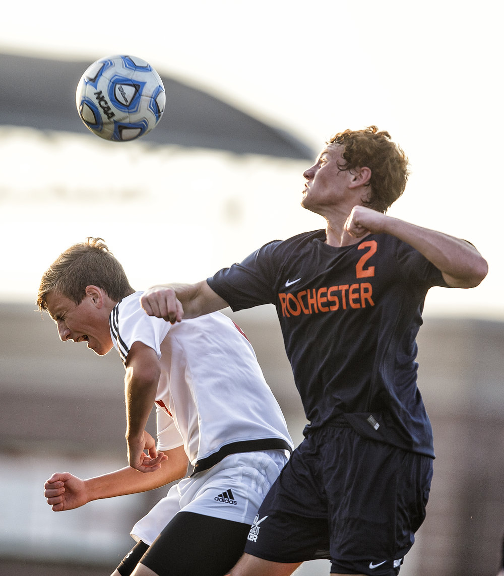 Glenwood's Evan Paoni (8) collides with Rochester's Will Eller (2) in the air as they go for a header in the first half at Glenwood High School, Tuesday, Aug. 30, 2016, in Chatham, Ill. Justin L. Fowler/The State Journal-Register
