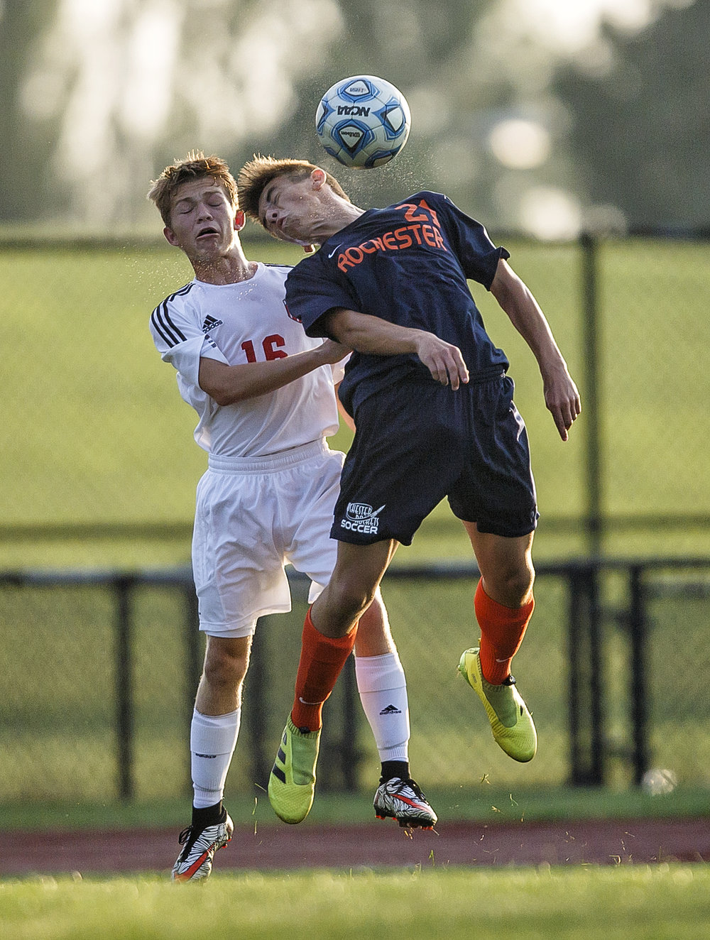 Rochester's Justin Meadows (21) wins a header over Glenwood's Matt Klein (16) in the first half at Glenwood High School, Tuesday, Aug. 30, 2016, in Chatham, Ill. Justin L. Fowler/The State Journal-Register
